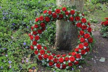 Funeral wreath near a tree
