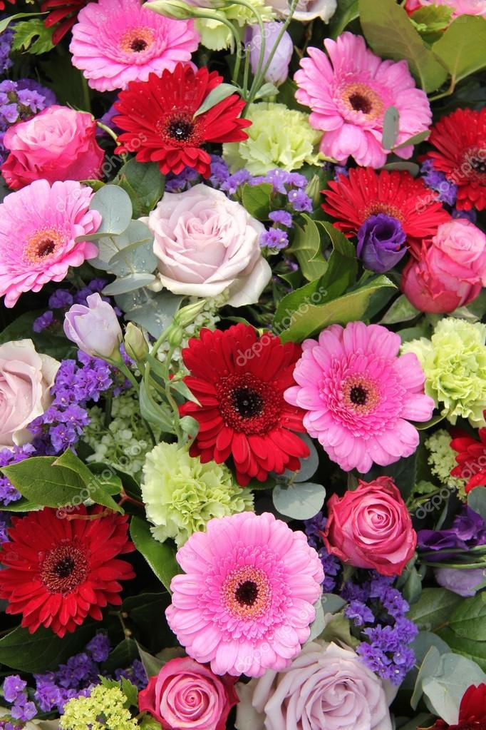Wedding arrangement in red, purple and pink