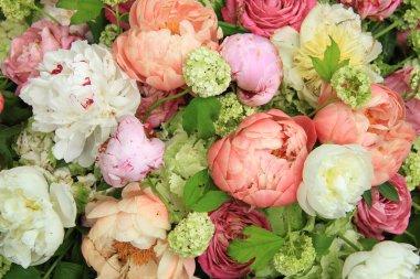 Peonies in a wedding arrangement