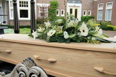 Funeral flowers on a casket