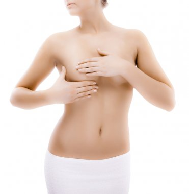 Woman examining her breast isolated on white background