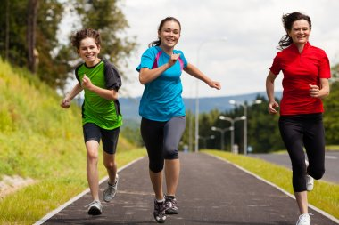 Healthy lifestyle - mother and kids running outdoor