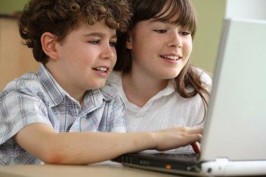 Kids using laptop