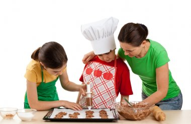 Mom with kids making cakes