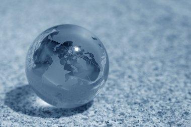 Glass globe on water