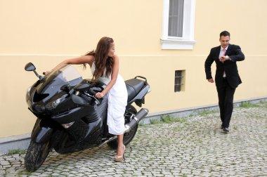 Young wedding couple with motorbike