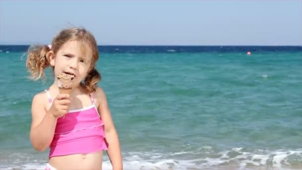 Little girl eat ice cream on beach