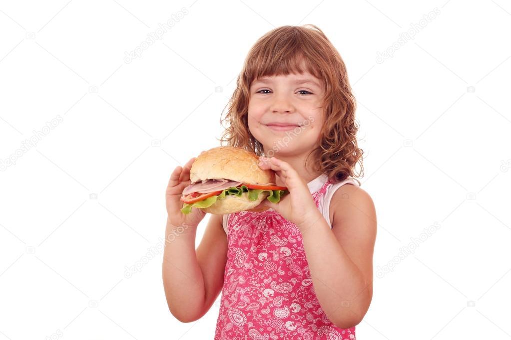 Happy little girl with big sandwich