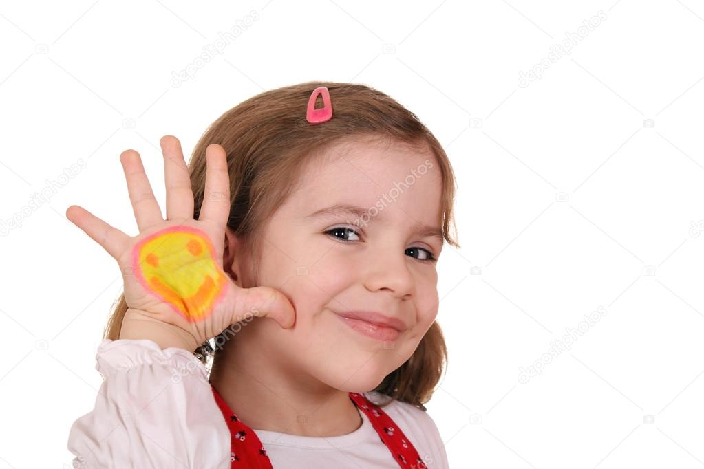 Beautiful little girl with smiley on hand