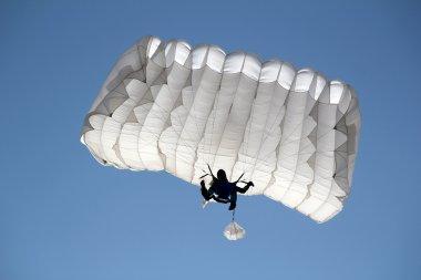 parachutist on blue sky extreme sport