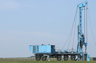 geology and oil exploration mobile drilling rig vehicle on field