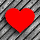 Fotografie Červené srdce na pozadí Dřevěná prkna