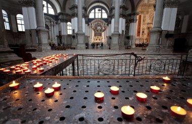 Candles in Santa Maria della Salute at Venice, Italy stock vector