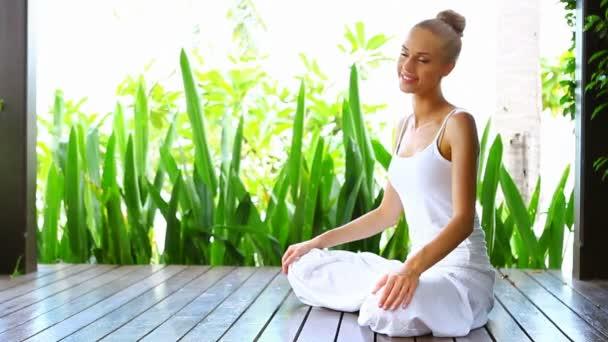 Woman practising yoga and meditating