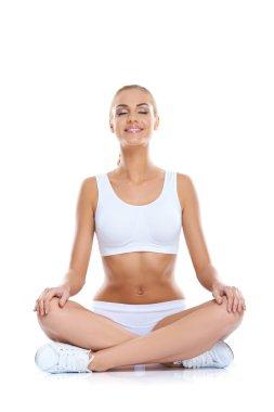 Serene happy woman meditating
