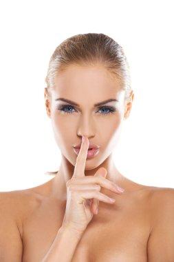 Woman making a shushing gesture