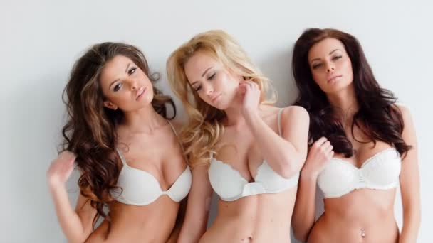 Young women wearing white lingerie