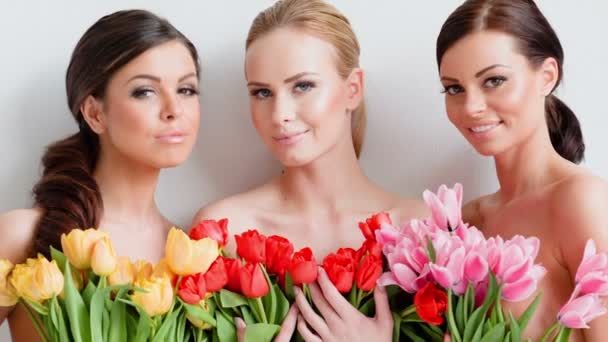 Women with bunches of  tulips
