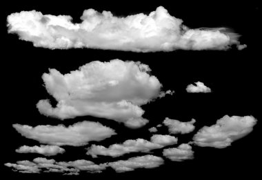 Set of isolated clouds over black.