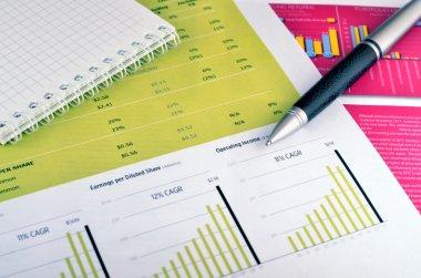 Pen, diary over graph
