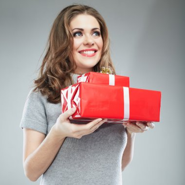 Young woman hold gift box . Smiling happy girl on white background. Female model. stock vector