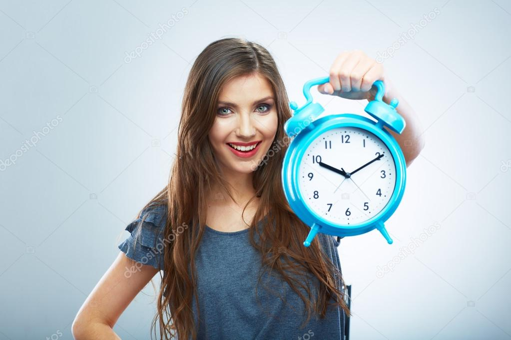 Young smiling woman hold watch.