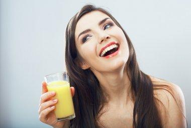 Portrait of woman drinking juice