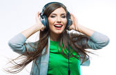 Woman with headphones listening music .
