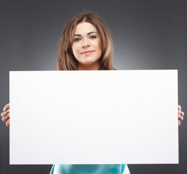 Portrait of woman with blank white board