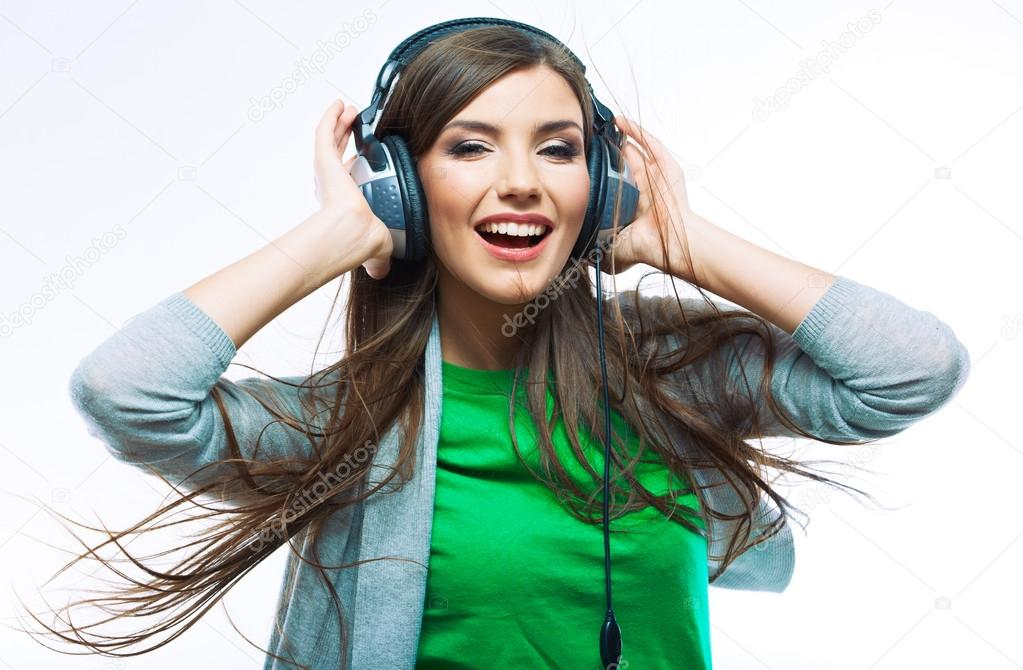 Woman with headphones listening music .