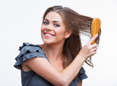 Fotografie kvinna kamma håret