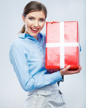 Business woman hold gift box in christmas color style, studio portrait. Young female model. stock vector