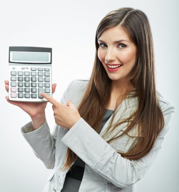 Woman holds calculator