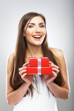 Beautiful smiling woman holds gift stock vector