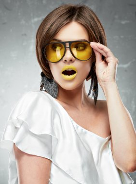Woman with yellow lips and glasses