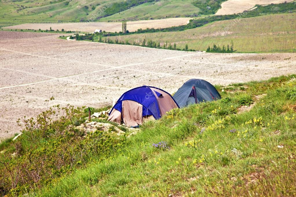 Tourist tents on verge of plateau