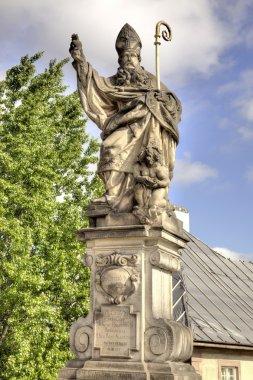 Ancient sculpture on the Charles Bridge. Prague. Blessed St. Aug