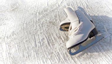 Women white skates. Abstract background on a winter sports theme