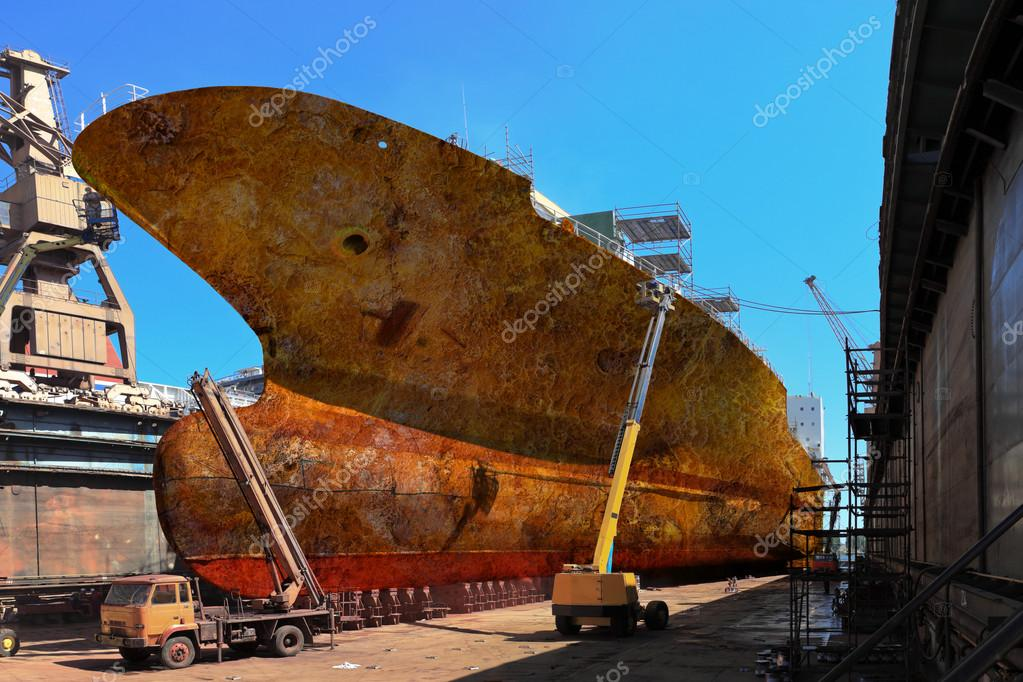 Rusty ship in dock