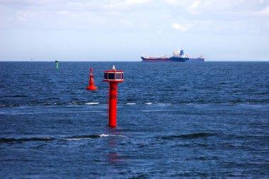 Cargo ships and buoy