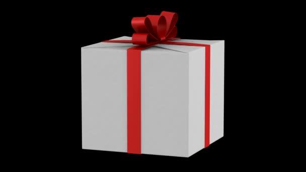 bílé krabičky s červenou stužku a luk smyčky otočit na černém pozadí