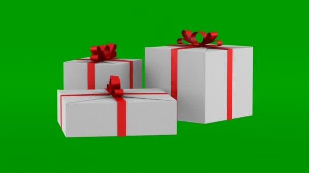 tři bílé dárkové krabičky s červenou stužku a luk smyčky otočit na pozadí zelených chromakey