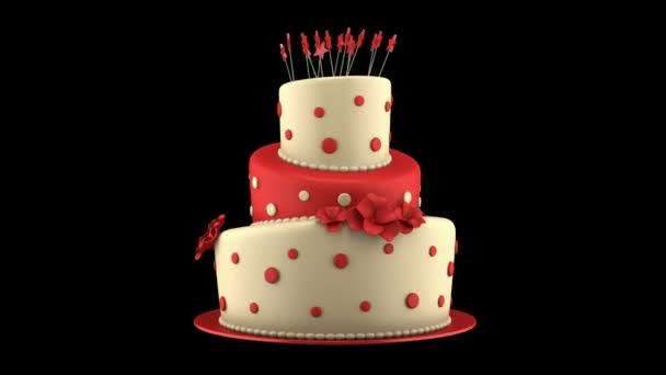 nagy kerek piros és sárga torta hurok forog, a fekete háttér