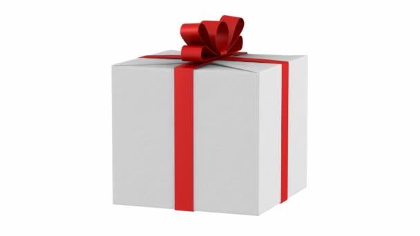 dárková krabička s červenou stužku a luk smyčky otočit bílé pozadí