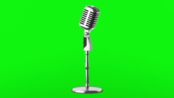Vintage Mikrofonschleife drehen auf grünem Chromakey-Hintergrund
