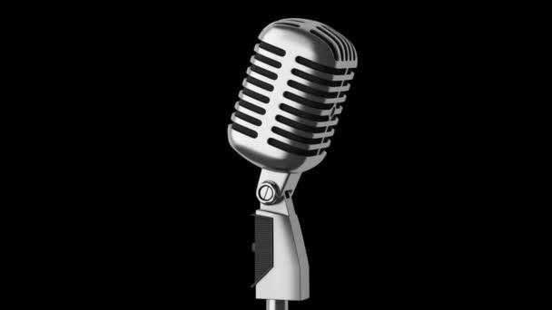 Vintage Mikrofon Schleife drehen auf schwarzem Hintergrund