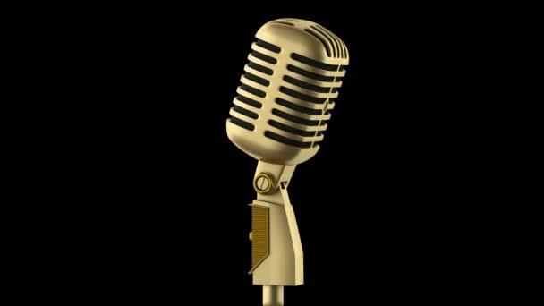 arany vintage mikrofon hurok forog, a fekete háttér