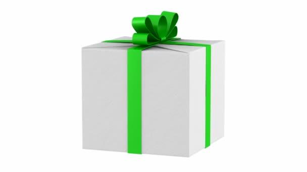 dárková krabička s zelenou stuhu a luk smyčky otočit na bílém pozadí