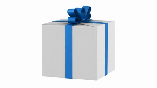 dárková krabička s modrou stužkou a luk smyčky otočit na bílém pozadí