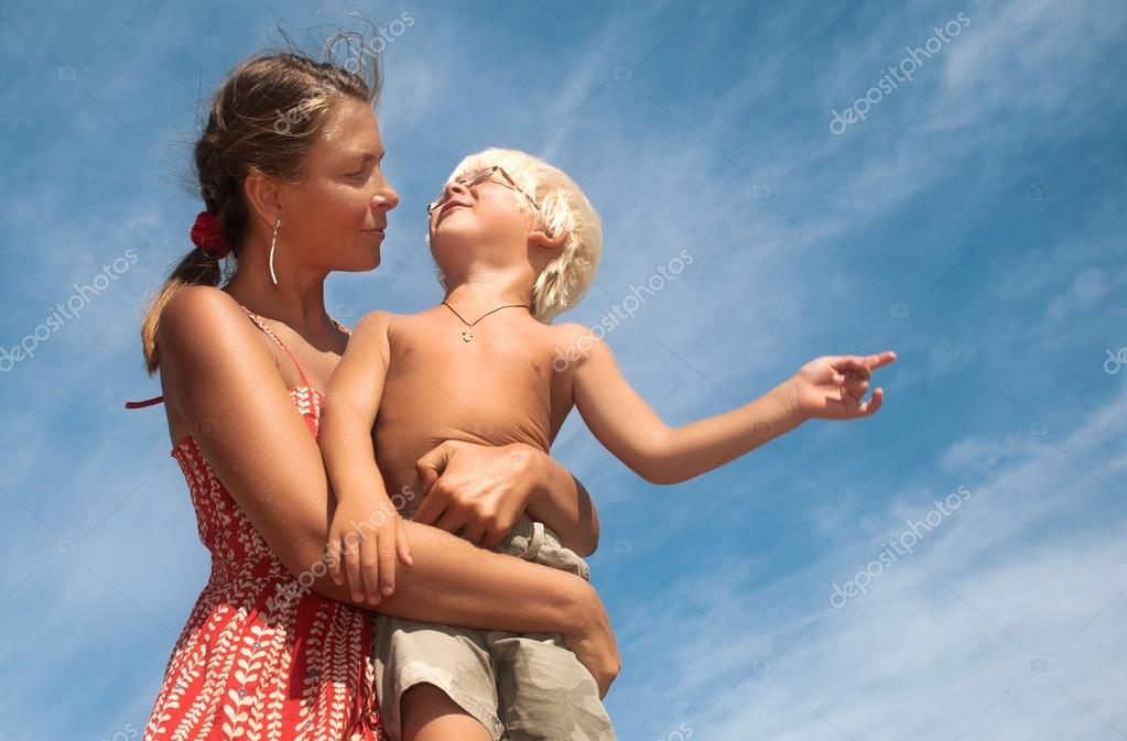 Mother and son on a background of sky